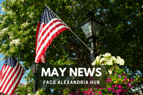 a lamppost, flowers, and an American flag in Old Town Alexandria